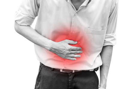 expresion corporal: Hombre que sufre de dolor de est�mago porque tiene diarrea Foto de archivo