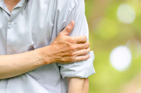 back rub: Young attractive business man having shoulder pain Stock Photo