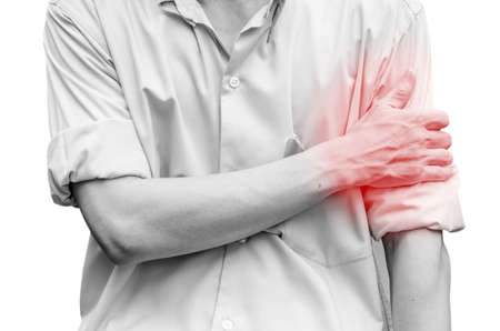 Young attractive business man having shoulder pain isolated