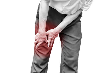 calf pain: Businessman office man with leg calf pain Stock Photo