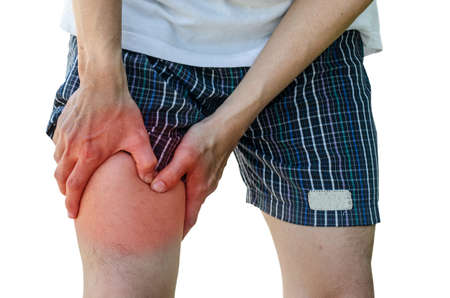 calf pain: man with leg calf pain isolated on pure white background Stock Photo