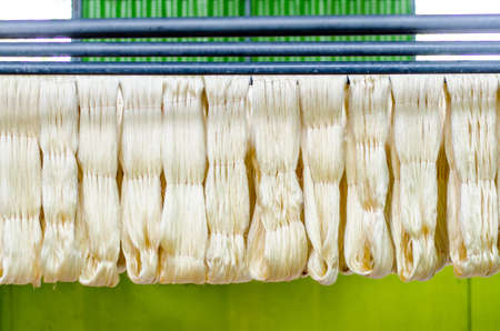 silk thread: Raw silk thread in the silk farm Stock Photo