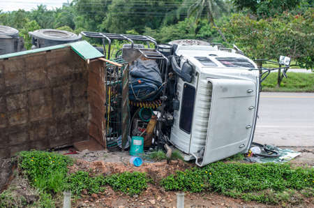 overturned: Overturned truck on an highway in an accident. Stock Photo