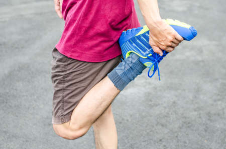 Man warming up before running , Fitness and lifestyle concept. Stock Photo