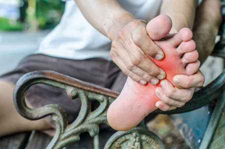 pedicure: Pain in the foot. Massage of male feet. Pedicures.
