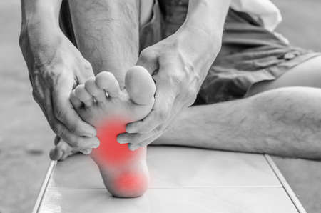 heel: Pain in the foot. Massage of male feet. Pedicures.
