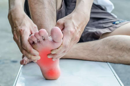 Pain in the foot. Massage of male feet. Pedicures.
