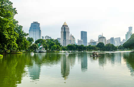 lumpini: BANGKOK - Nov 7: Lake view of Lumpini Park in the Thai capitals city centre on july 7, 2015 in Bangkok, Thailand. Lumpini Park covers 142 acres with 2.5 km of pathways and a large boating lake.