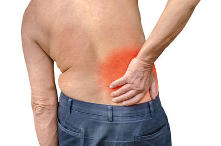 seniors suffering painful illness: close up of a Senior man holding his back in pain, monochrome photo with red as a symbol for the hardening
