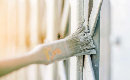 maintains: painting  door in grey color by brush Stock Photo