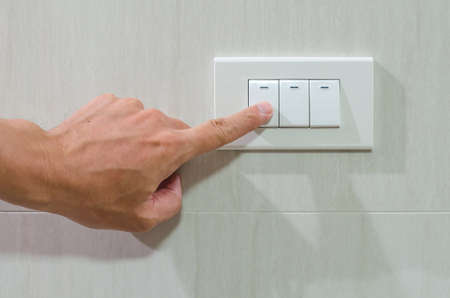 turned out: Finger put off switch for save energy concept