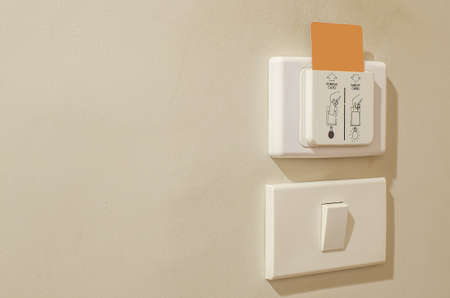 in insert: device card insert to power switch control of the electric in the room Stock Photo