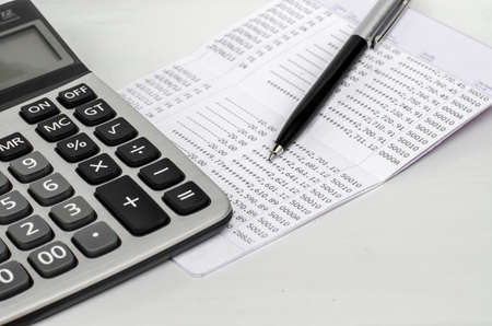 account statements: Bank account passbook with pen and calculator Stock Photo