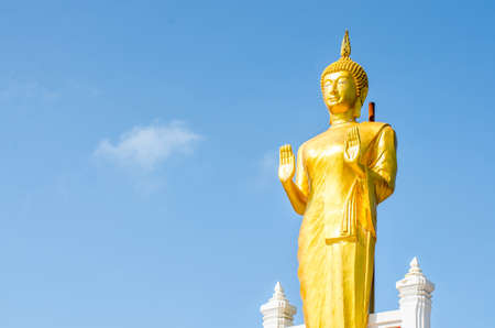 spiritual architecture: Gold Buddha Statue on blue sky background