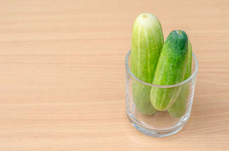 lug: Fresh cucumbers in gass on wood. Green cucumber from Thailand. Stock Photo