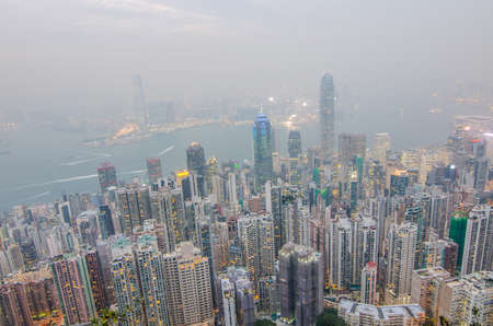 Hong Kong the scenes, victoria harbour from the peak bird view, in the mist with bad weather in the evening, nimbus landscape on the trails