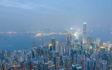 Hong Kong the scenes, victoria harbour from the peak bird view, in the mist with bad weather in the night, nimbus landscape on the trails Stock Photo