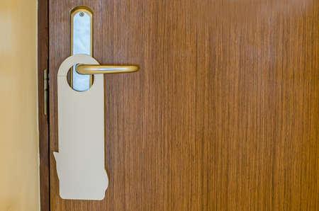 Door of hotel room with empty sign please do not disturb Stock Photo