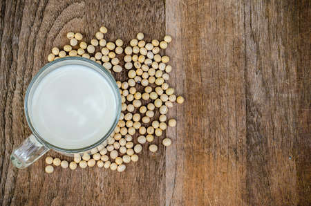 top view of soy milk and soy beans with wood background