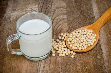 soja: Soy milk and soy bean on wooden background