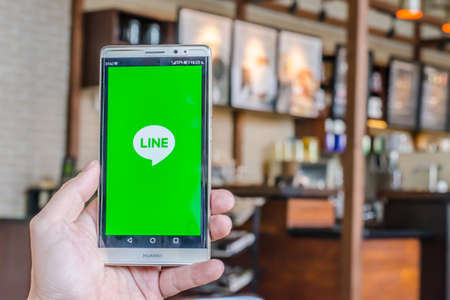 5s: BANGKOK, THAILAND - April 18, 2017. Line app logo display on screen huawei in male hands on April 18,2017 in Thailand.