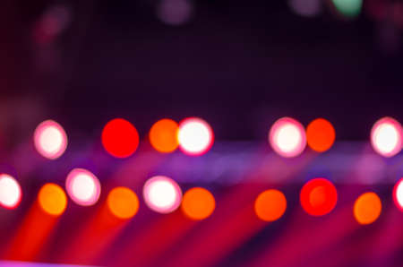 Defocused entertainment concert lighting on stage, blurred disco party. Stock Photo