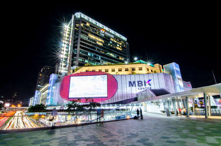 Bangkok,Thailand - 2 November 2017 : Night light with long speed shutter of traffic at MBK, BTS Siam interchange in front of Siam Discovery and Art Museum junction.This place is very famous shopping mall at central of Bangkok