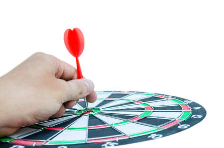 hand holding a dart into the center on white background, business concept