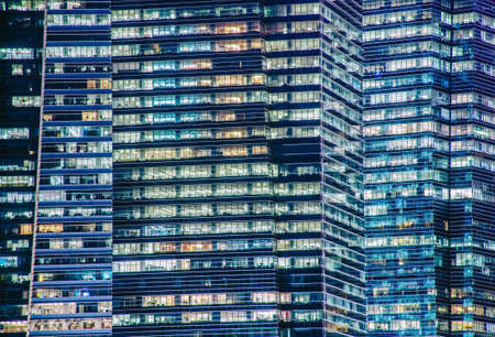 Close - up of a highly-detailed night windows pattern of modern metropolis.