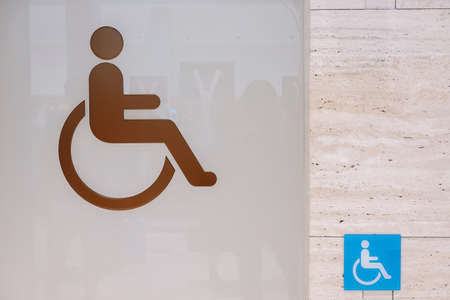 Close up of toilet door with disable sign 写真素材