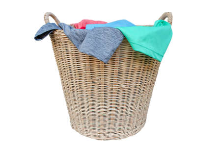 Clothes in a laundry wooden basket, Household chore concept isolated on white background