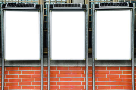 Three blank picture frames on brick wall, Template Mock up for your content. For product display and advertising and promotional purposes