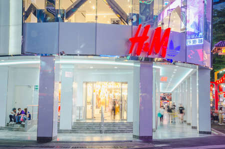 TAIPEI, TAIWAN - May 15, 2018: H&M store at night in the Ximending Pedestrian Area. H&M is a Swedish clothing company. This brand is a famous clothing fashion design for people of all ages. Editorial