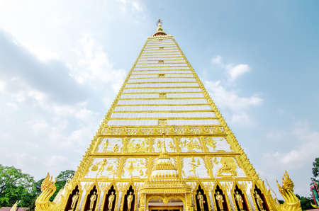 4-sided shape pagoda : architecture landscape of white and gold pagoda at wat Phrathat Nong Bua in Ubon Ratchathani province, Thailand