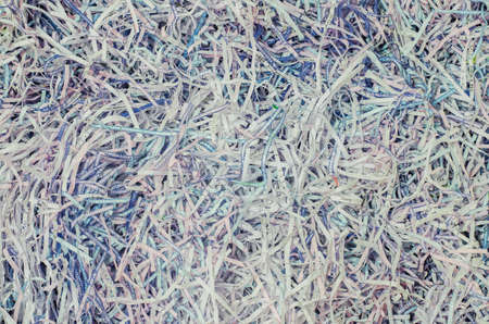 A tangled pile of paper cut into small pieces. Paper surface wallpaper background. Imagens