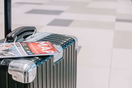 SINGAPORE - NOVEMBER  22, 2018: Traveling luggage in airport terminal with  tourist map , travel concept
