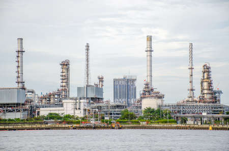 Oil refinery plant of Petrochemistry industry in sunset time, gas and oil production processing in Bangkok, Thailand.