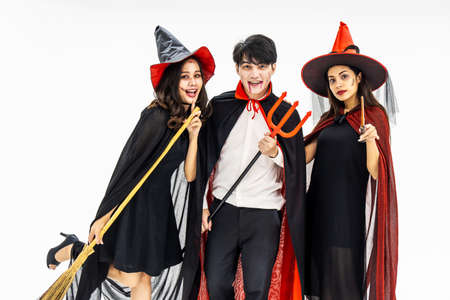 Three young people dressed in different costumes for Halloween, isolated on white background Standard-Bild