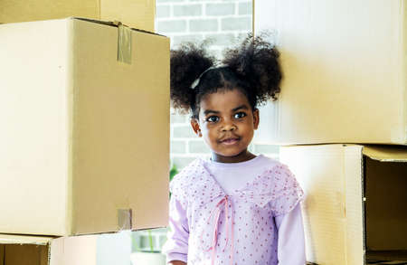 Relocating delivery services. Delivering happiness, African american cute baby girl enjoy playing with cardboard box at home, Insurance post package. Deliver your treasures. Storage for toys.