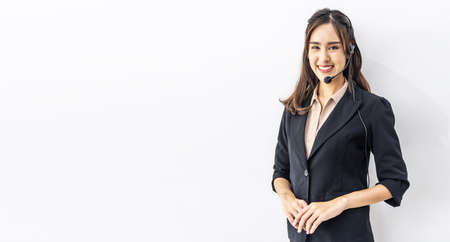 Confident customer service representative. Portrait of happy smiling cheerful asian young female customer service representative in headset looking at camera while isolated on white background