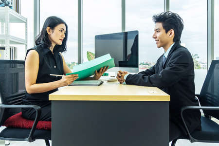 Job interview, Beautiful manager asian woman talking to a male job applicant at the desk, Businesswoman listen to candidate answers.