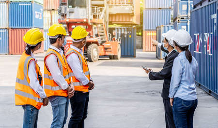Worker team meeting and training, Logistics and transportation business Containers import concept, The supervisor is meeting with a team of engineers about what to do today Banco de Imagens