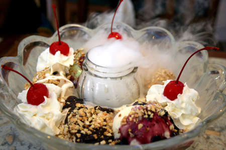 Large bowl of ice-cream with eight scoops of flavors photo