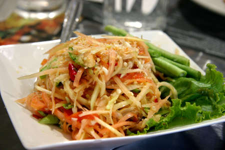 Thai young papaya salad photo