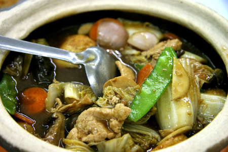 A mixture of vegetables boiled and served in a hot pot, still simmering. photo