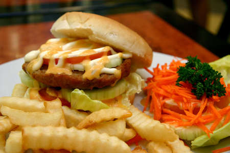 side of beef: Beef burger with crinkle cut fries and shredded carrot side salad