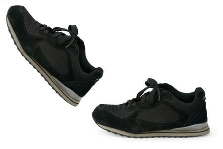 black grip: Two left foot black shoes with one taking a step ahead of the other in the air