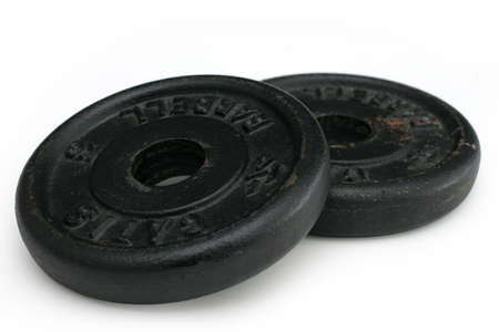 circular muscle: two standard iron weights for dumbells Stock Photo