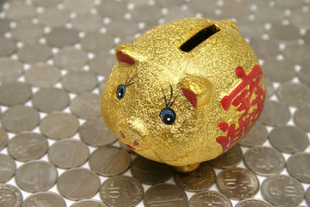 splayed: Chinese Piggy-bank money box with a prosperity symbol on a floor of money