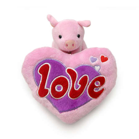 heartshaped: Piggy with large heartshaped cushion with Stock Photo